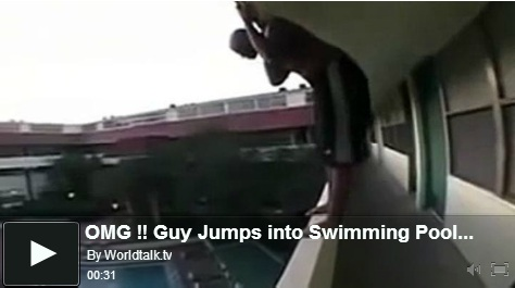 guy-jumps-into-swimming-pool-